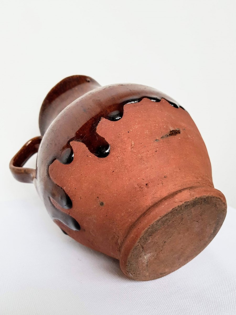 Part Glazed Terracotta Jug